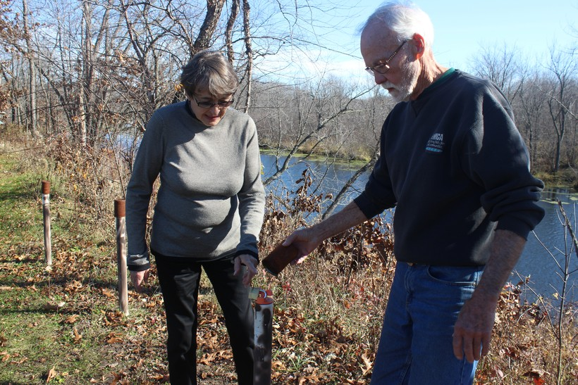 Doug and Sherryl Jones show a monitoring well on their property in rural Spring Green.