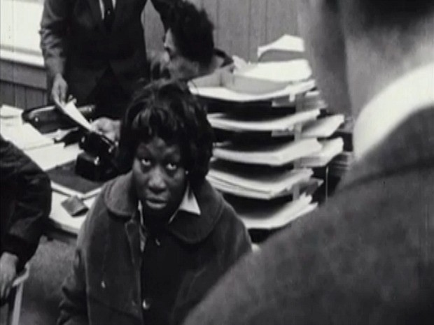 "A screenshot from the 1968 documentary ""Pretty Soon Run Out,"" showing a Milwaukee resident speaking with city officials about housing"