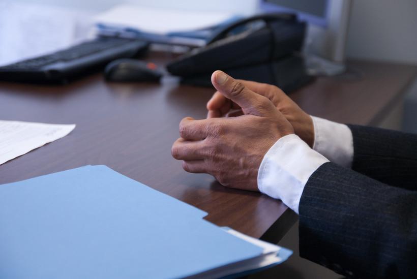 Hands on business desk