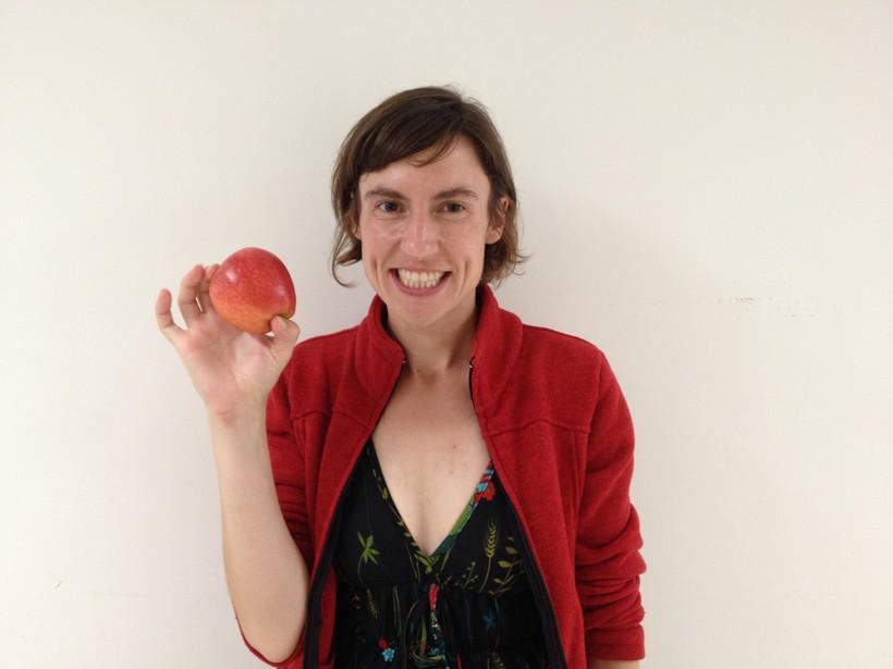 Erika Janik with an apple