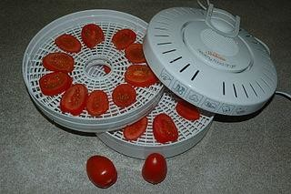 Tomato in food dehydrator, image by Wikimedia Commons user Latch
