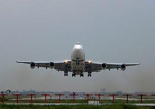 airplane taking off, photo via Wikimedia Commons, by Waqas Usman
