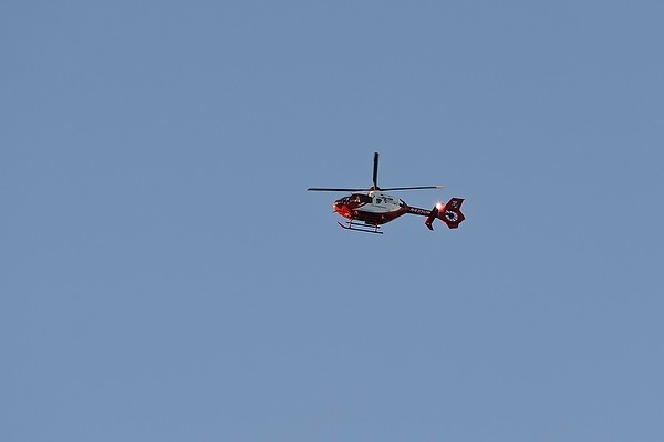 A UW Med Flight helicopter flies above the University of Wisconsin-Madison campus during sunset on Sept. 13, 2013.