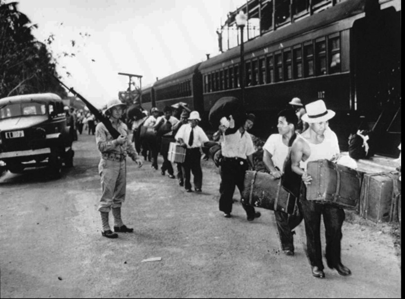 Japanese Latin Americans are shown in an unknown location en route to internment camps in the United States during World War II