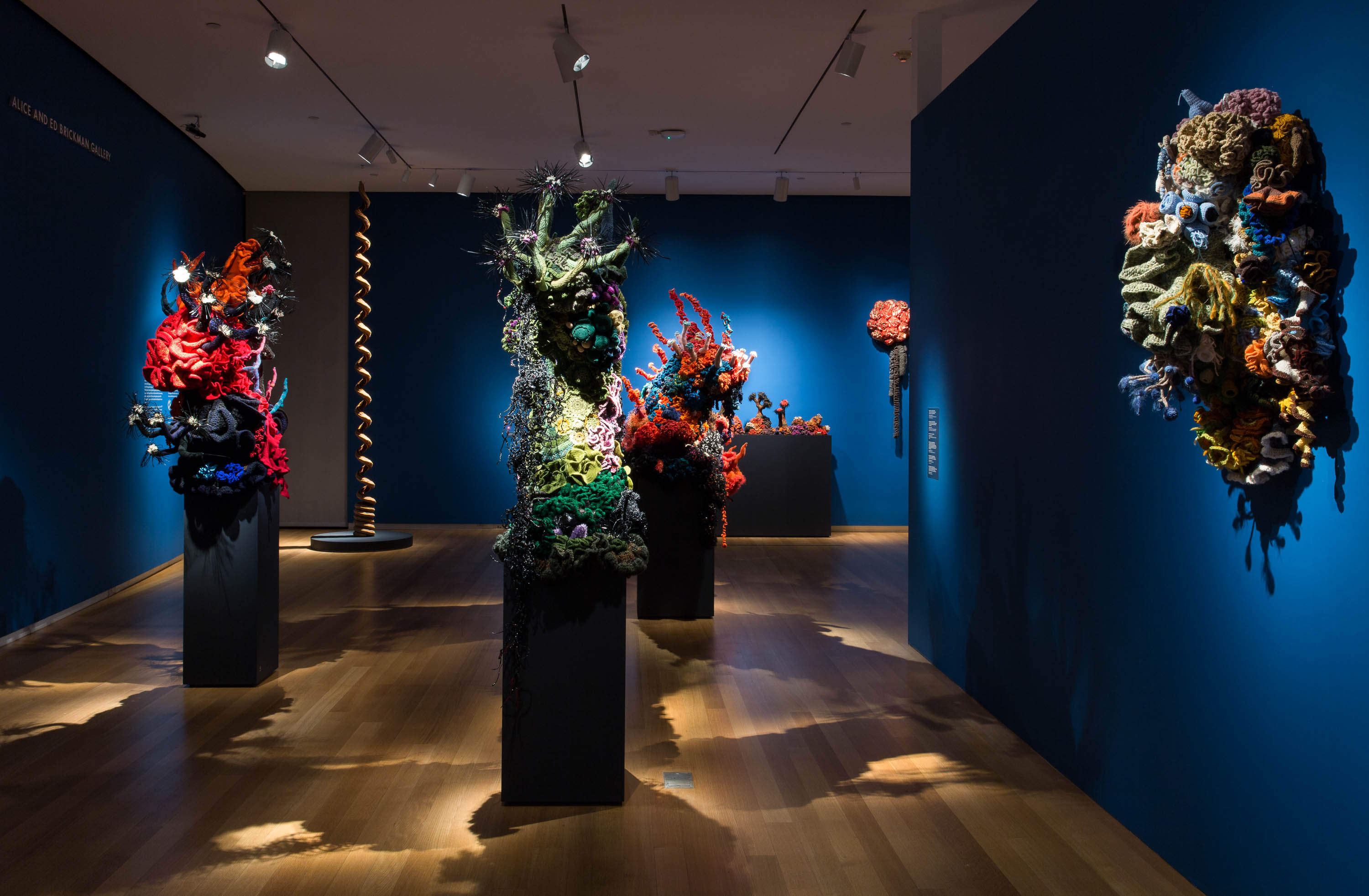 """Coral Forest"" from the ""Crochet Coral Reef"" project by Christine and Margaret Wertheim and the Institute For Figuring. At Museum of Arts and Design, NY 2017."