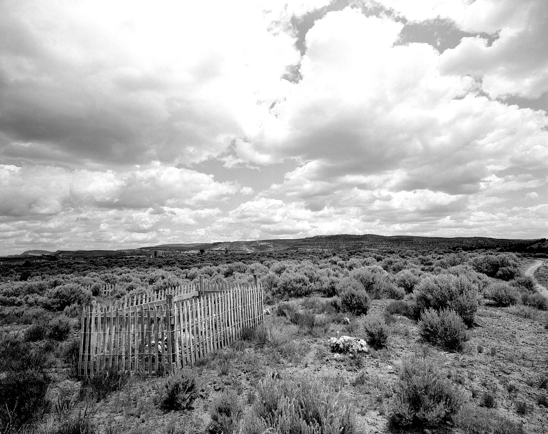 A fenced in gravesite in the open landscape of South Dakota, 1997