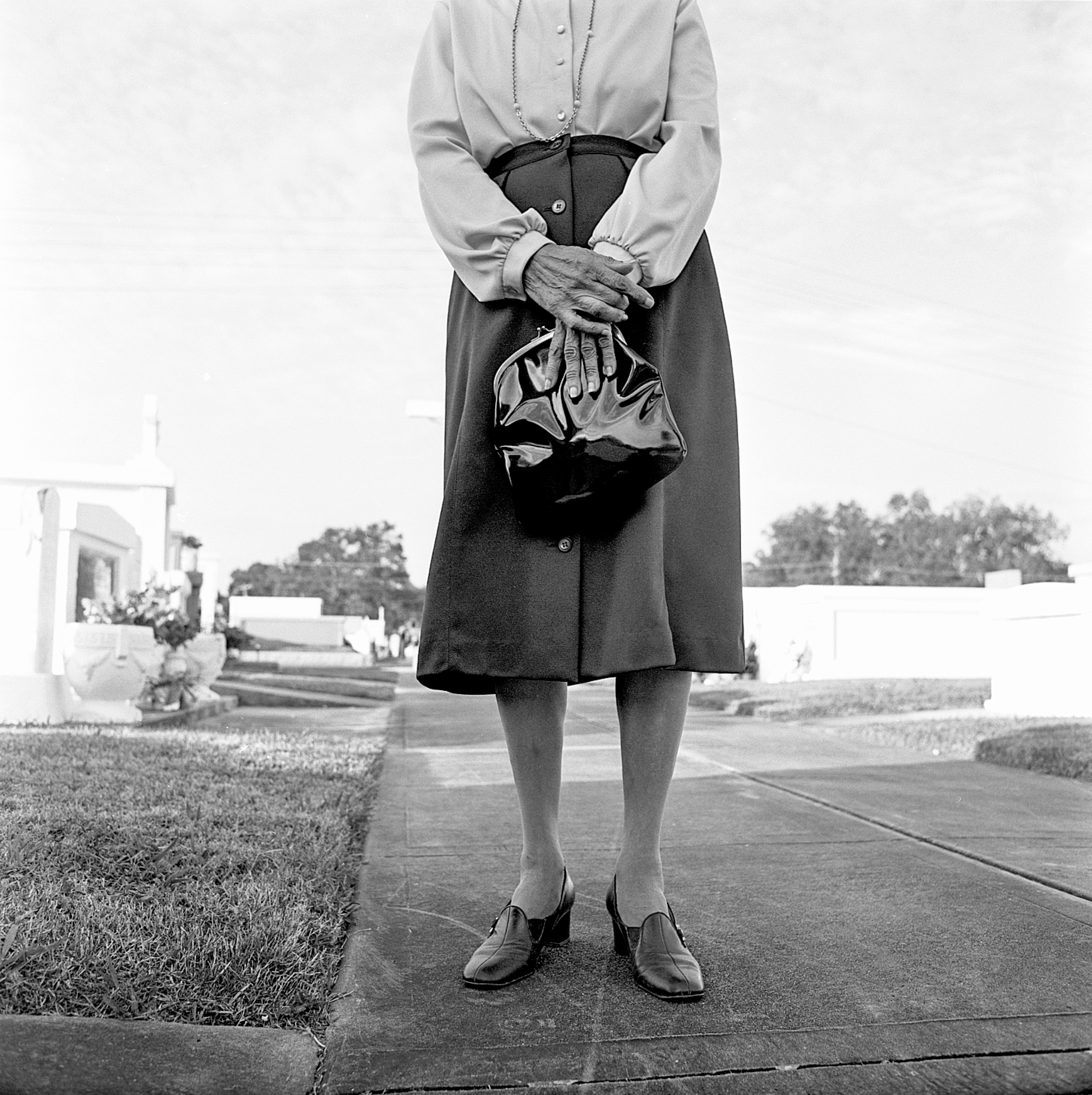 A woman visits the cemetery of St. Martinsville during All Saints Day, Louisiana, 1997