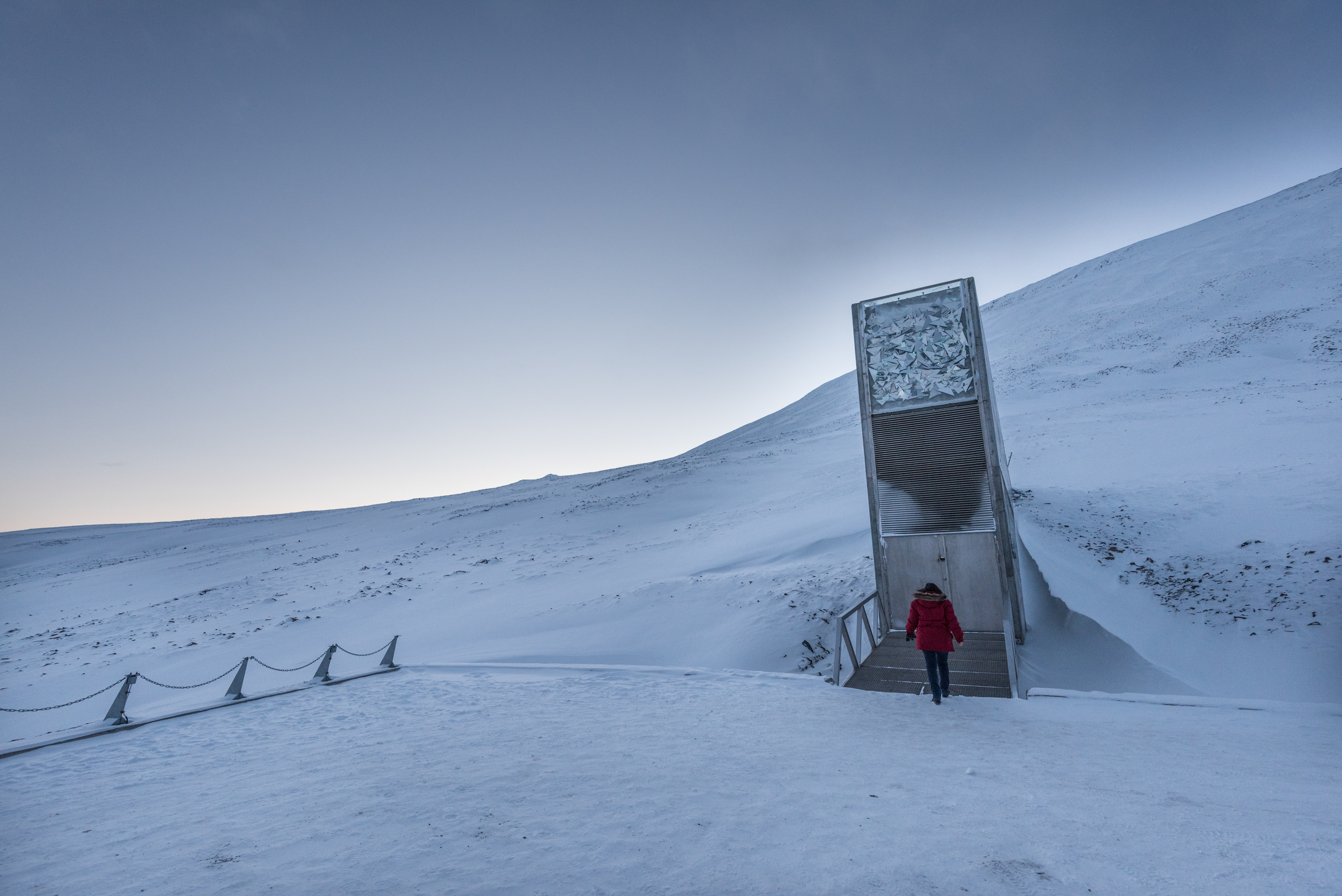 "Exterior of the Svalbard Global Seed Vault. <a href=""http://ttps://www.flickr.com/photos/croptrust/albums/72157667973253302""><em>Global Crop Diversity Trust (CC BY-NC-SA 2.0)</em></a>"