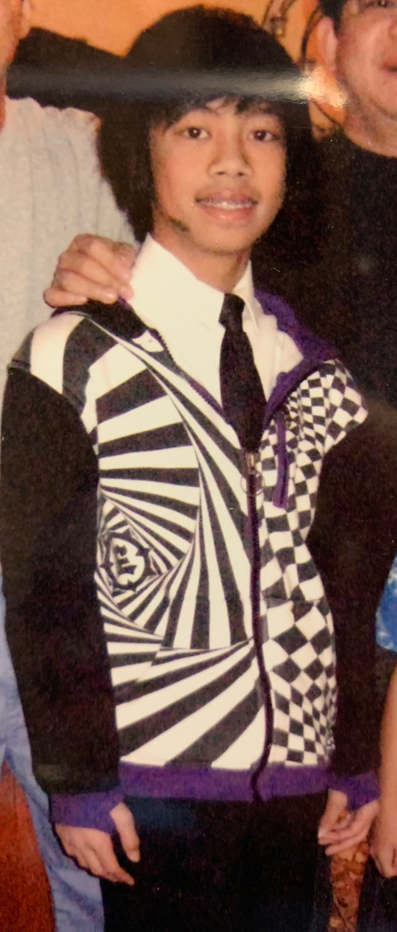 Yet another graphic hoodie with thumb holes. 7th grade Angelo thought the black, white and purple combination looked good.