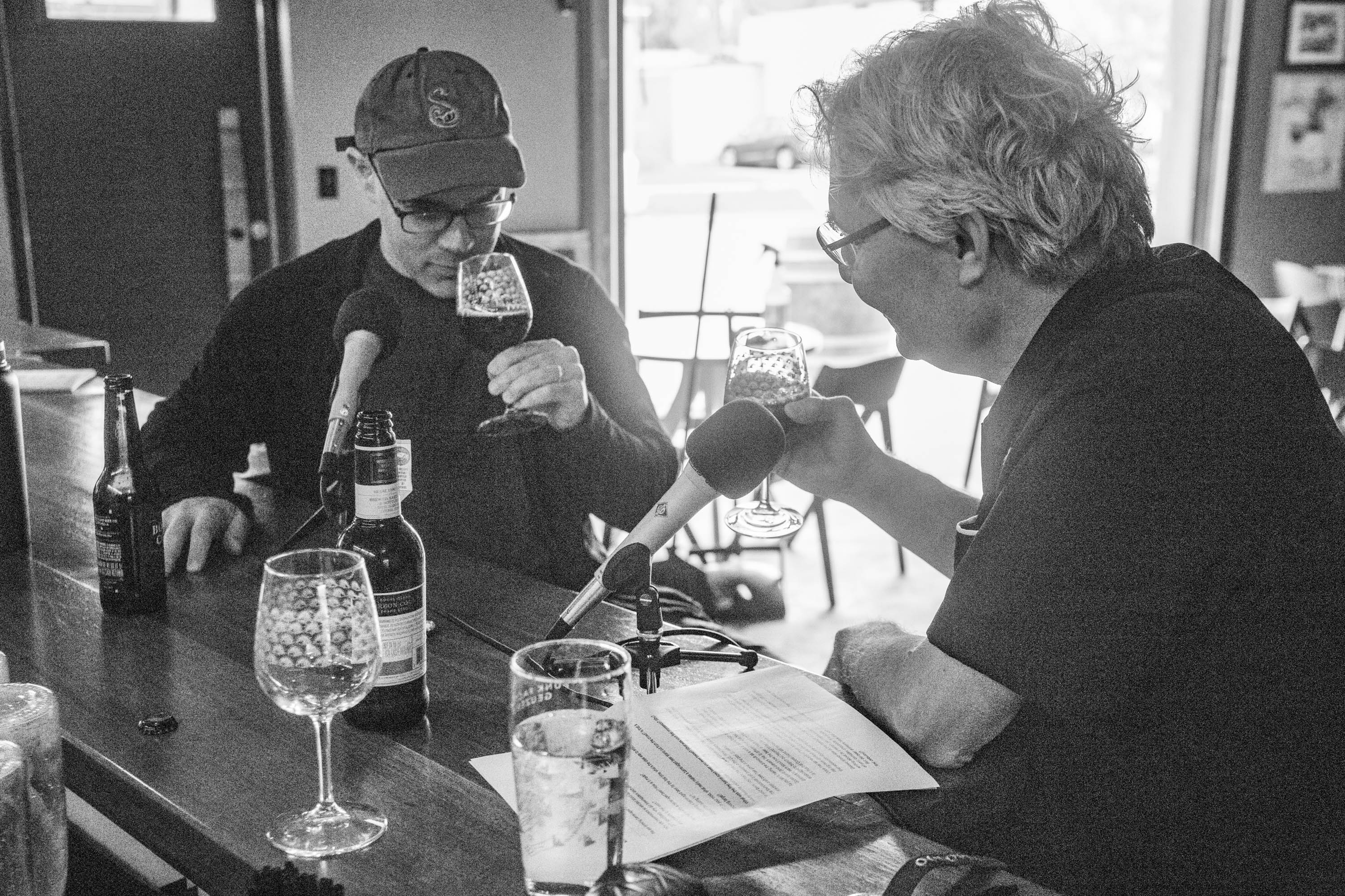 Josh Noel and Steve Paulson sample Goose Island Bourbon County Brand Stout (2014 and 2017) while chatting at the Funk Factory Geuzeria in Madison, Wisconsin. <em>Mark Riechers&nbsp;(TTBOOK)</em>