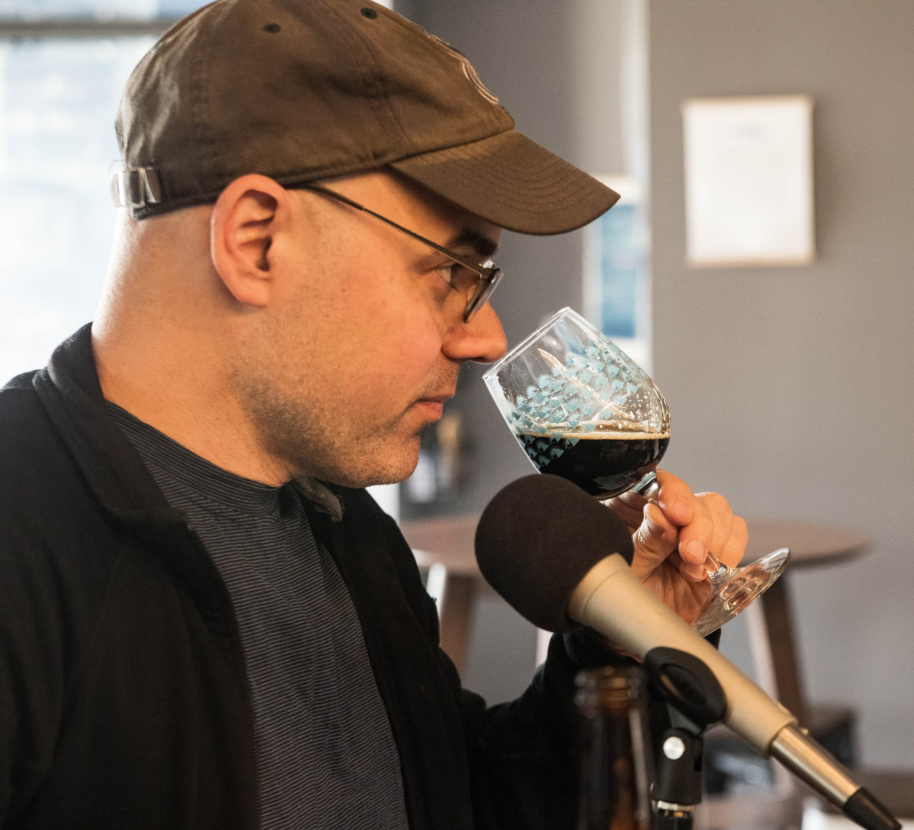 Josh Noel demonstrates his tasting technique while sampling&nbsp;Goose Island Bourbon County Brand Stout (2014 and 2017)&nbsp;at the Funk Factory Geuzeria in Madison, Wisconsin. <em>Mark Riechers&nbsp;(TTBOOK)</em>