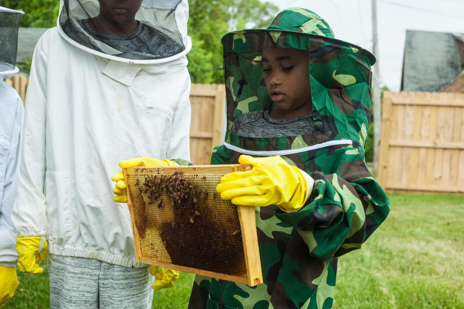 Students get some hands on time with the bees of the hive. (Detroit Hives)