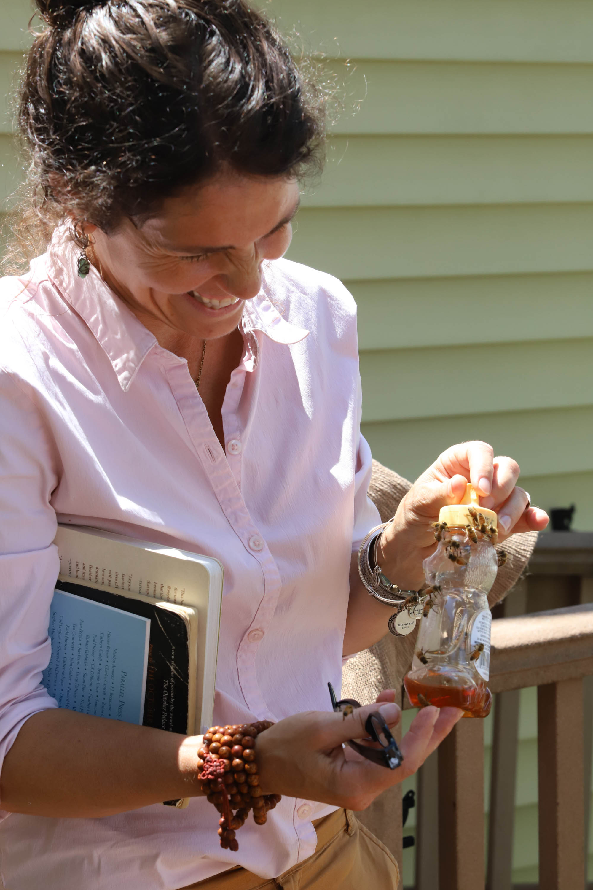 Heather attempts to separate some hungry bees from some of the leftovers from the taste test. <em>Shannon Henry Kleiber (TTBOOK)</em>