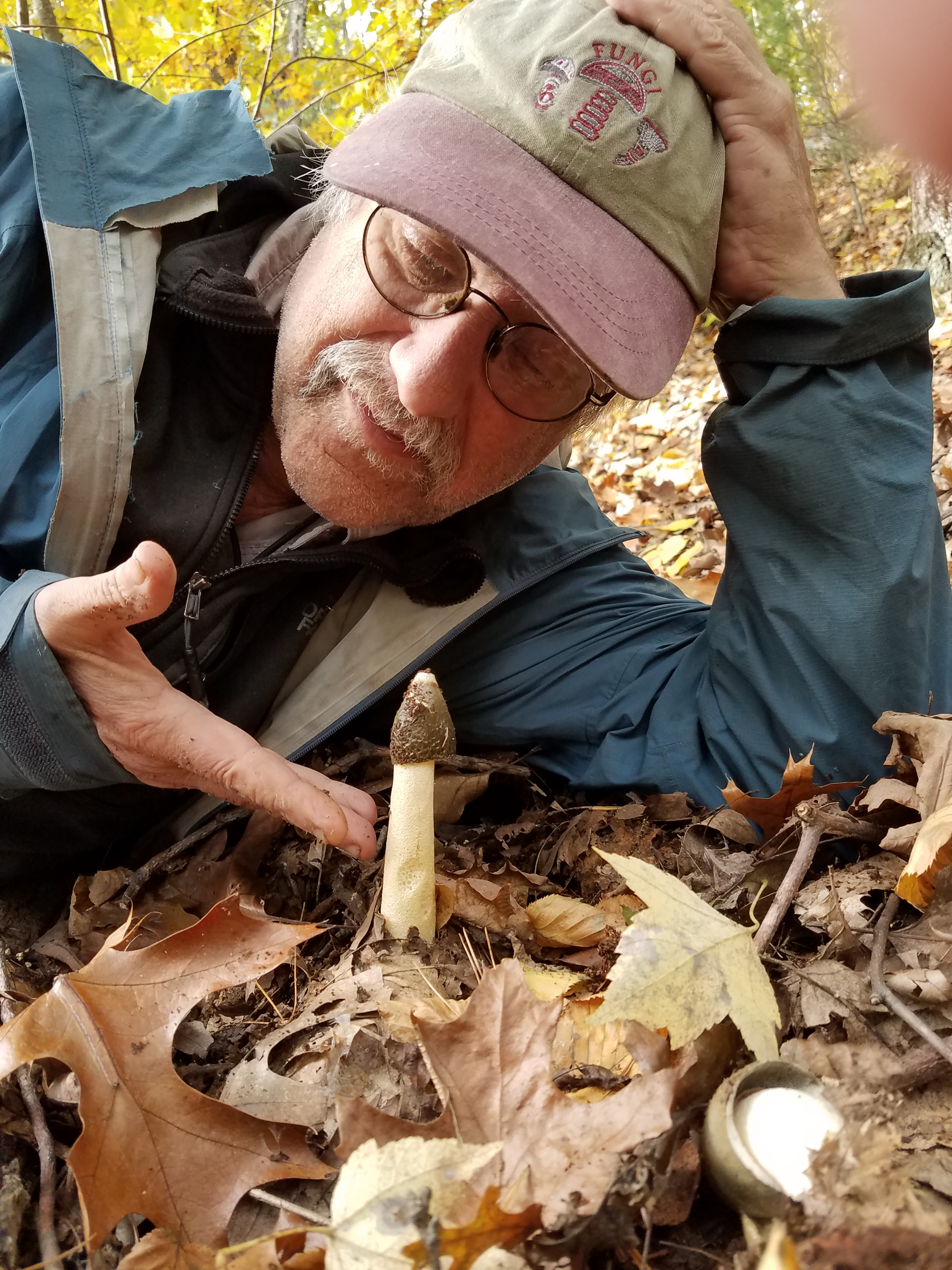 Lawrence Millman with a stinkhorn. <em>(Tim Ahern)</em>