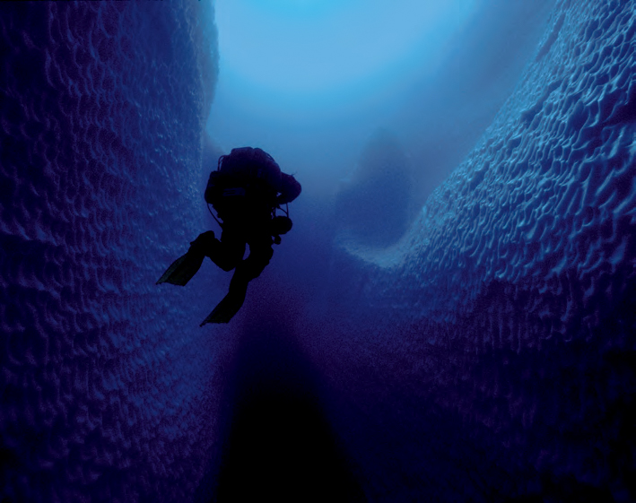 """Paul Heinerth leaves Ice Island Cave #4 in Antarctica after our first historic dive inside the iceberg."" <em>(Jill Heinerth)</em>"