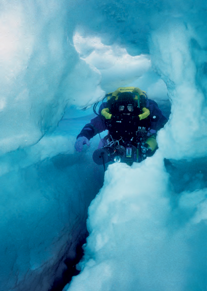 """Paul Heinerth weaves through icy tunnels inside an Antarctic iceberg."" <em>(Jill Heinerth)</em>"