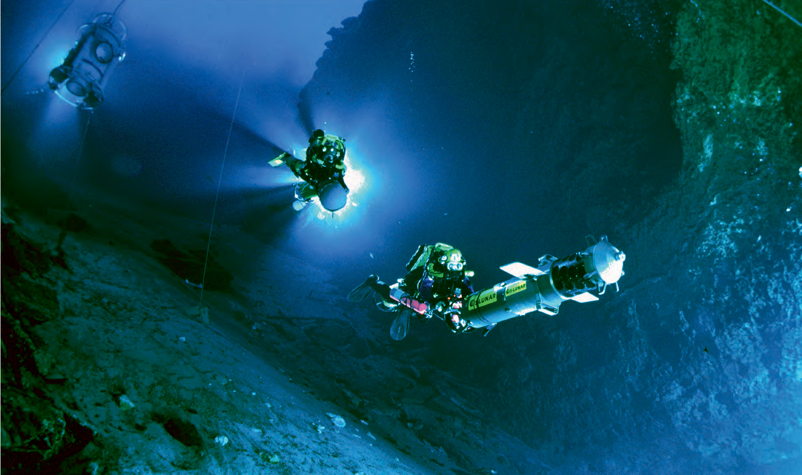 """I'm driving the digital wall mapper, pausing briefly for Wes Skiles to get the shot for National Geographic."" <em>Photo courtesy of the U.S. Deep Caving Team Inc. (Jill Heinerth)</em>"