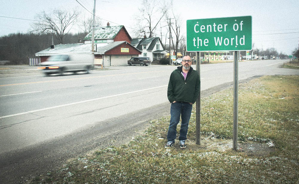 TTBOOK producer Charles Monroe-Kane standing in front of the famous sign for the town of Center of The World. Created as a gimmick in 1840 the sign and the town stand now more for irony than anything else.<em>Seth Jovaag (TTBOOK)</em>