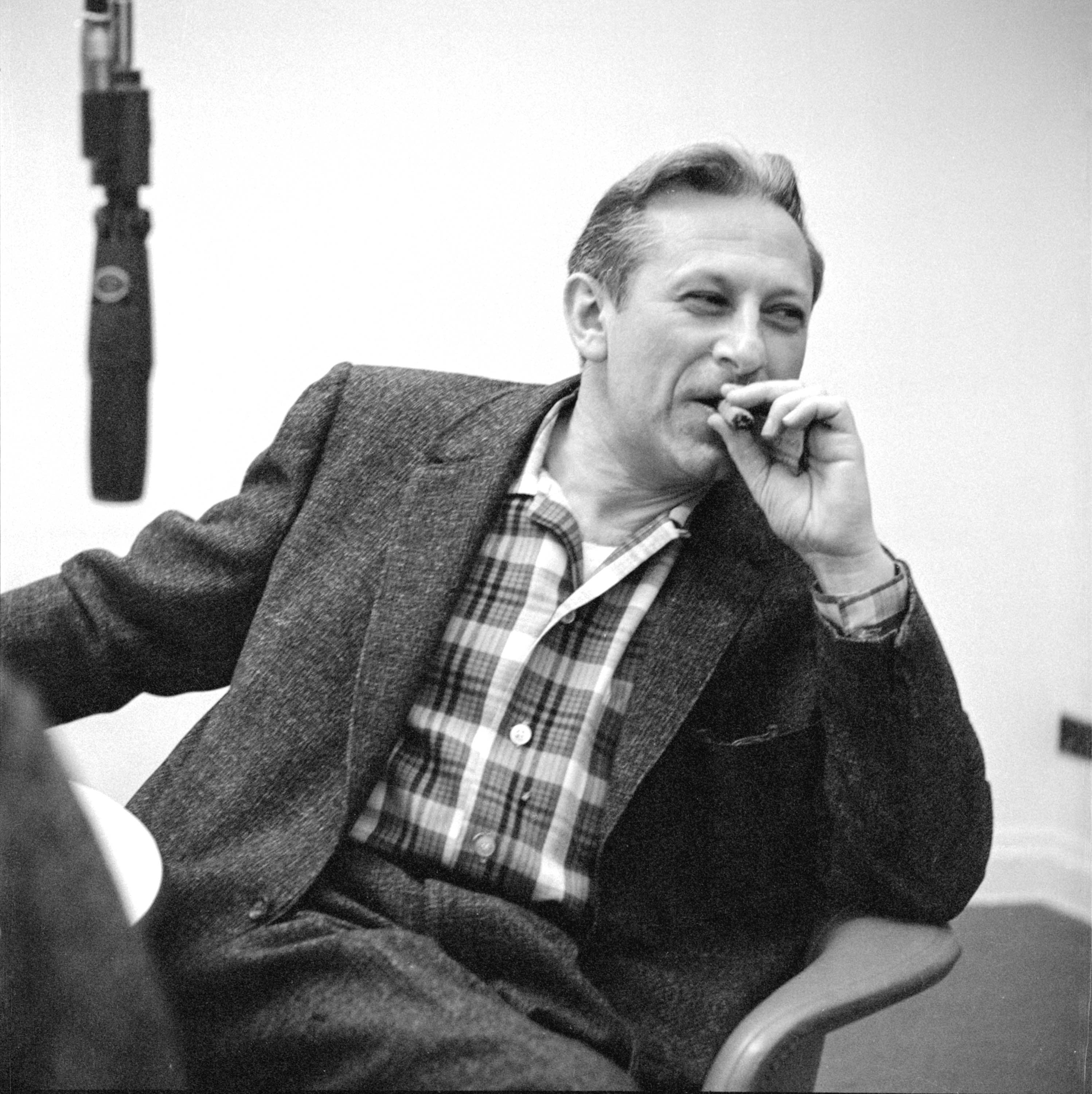 Studs Terkel smoking a cigar in a recording studio, Chicago, Illinois, circa 1960. <em>Chicago History Museum, ICHi-065442, Stephen Deutch, photographer</em>