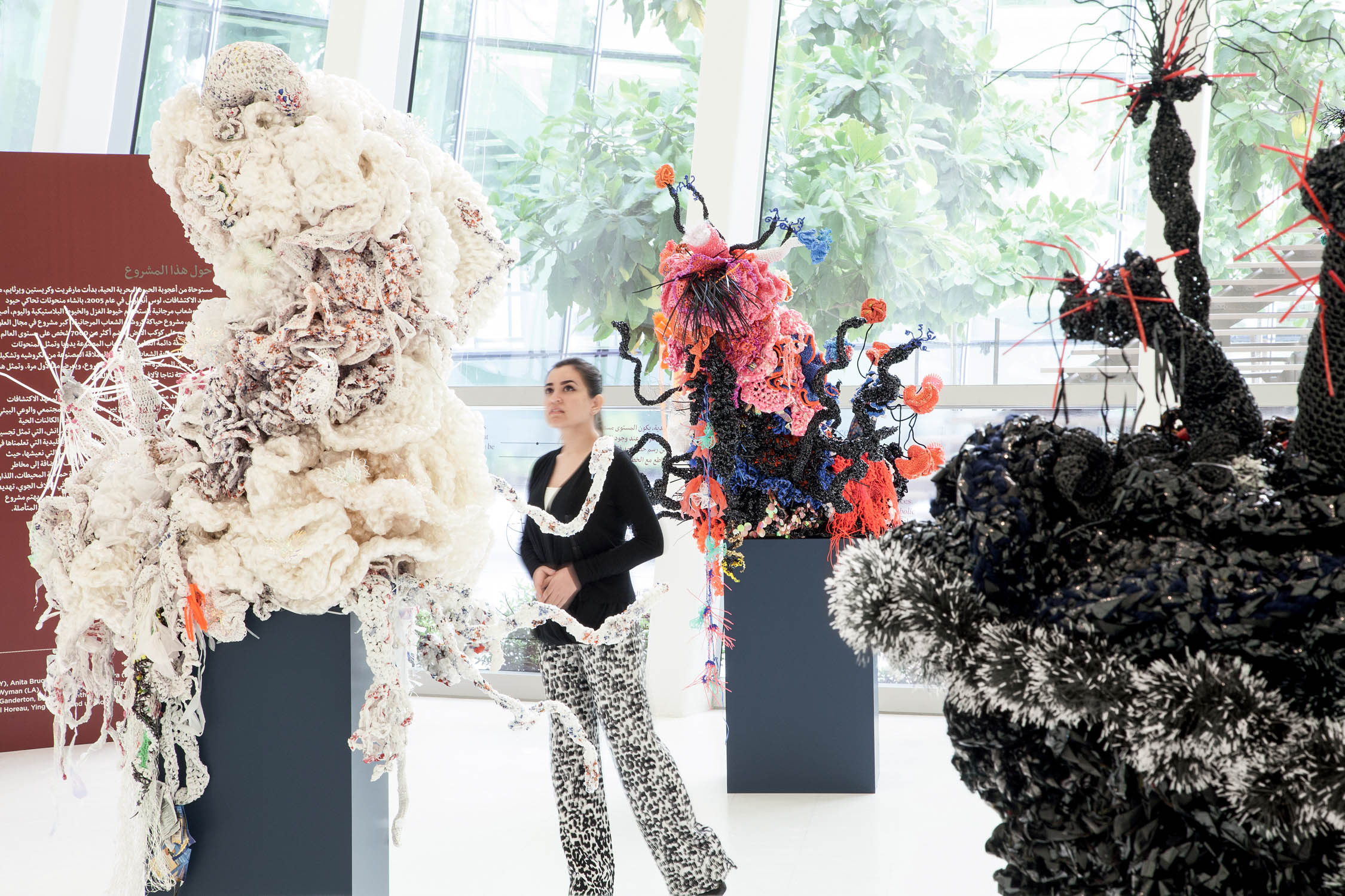 """Coral Forest"" sculptures made from plastic trash bags and videotape, from the ""Crochet Coral Reef"" project by Christine and Margaret Wertheim and the Institute For Figuring. At New York University Abu Dhabi, 2014."