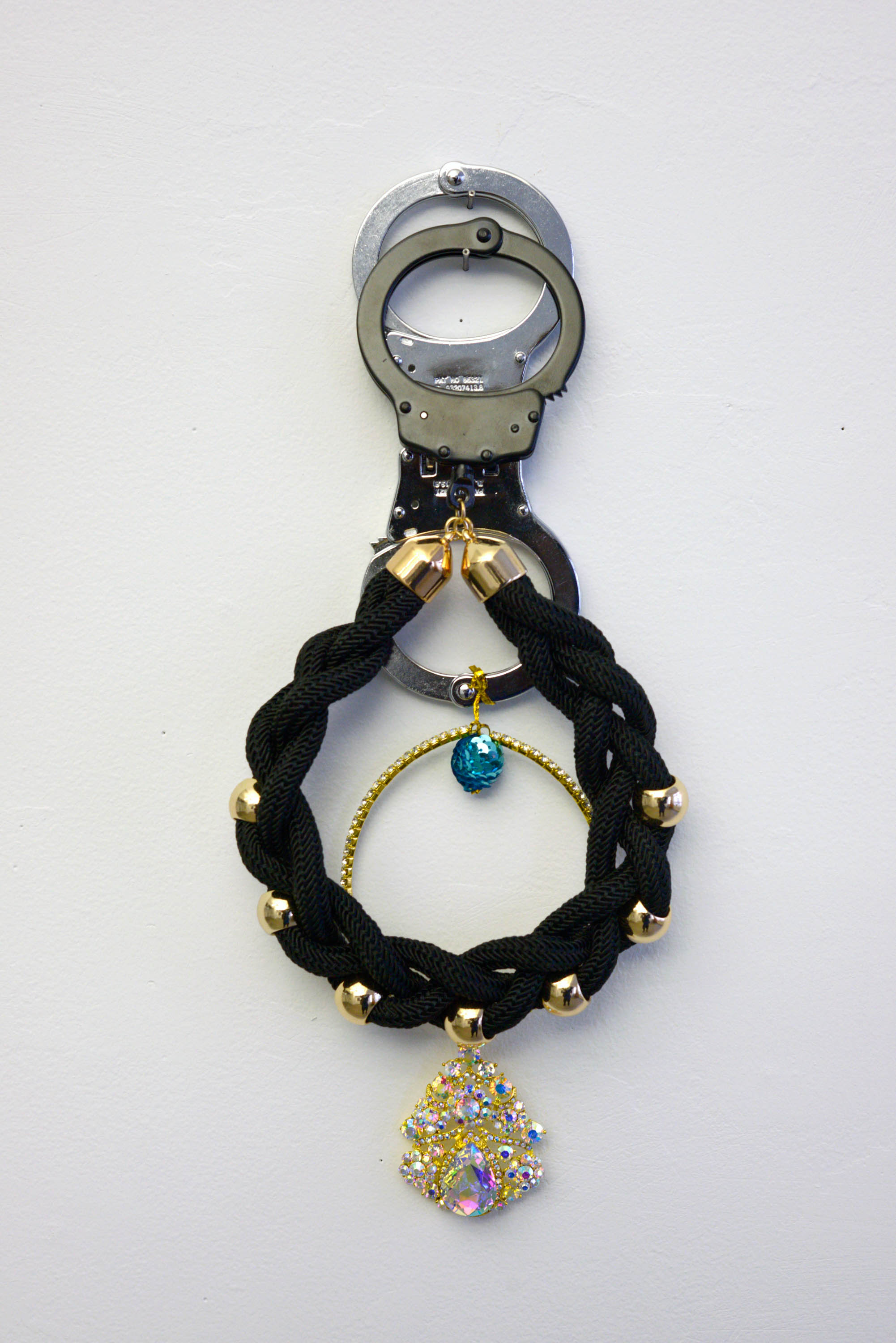 Kambui Olujimi,<em> Stowaway</em>, from the series <em>Killing Time</em>, 2017. 4 single handcuffs, costume jewelry. Variable dimensions. Courtesy of artist.