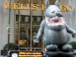 Giant inflatable rat in front of Wells Fargo
