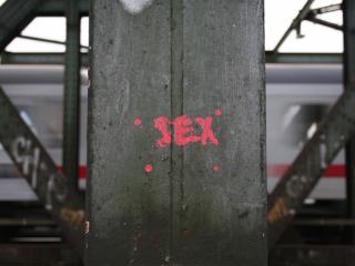"The word ""sex"" on an iron pillar"
