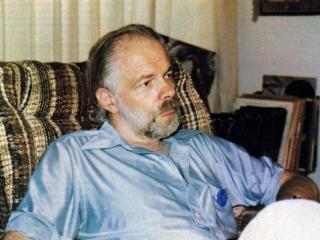 Philip K. Dick sitting in chair