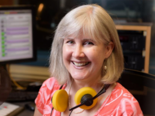 Color photo of Stephanie Elkins smiling in a recording booth