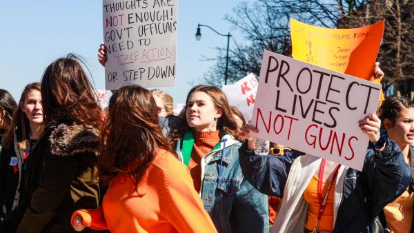 Teens walk out against gun violence on March 14 in Madison, Wis.