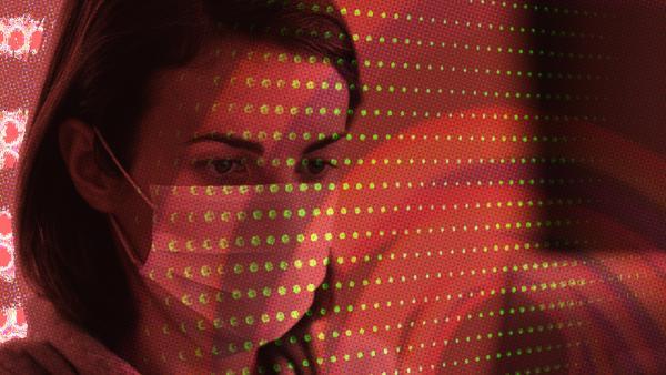 A woman behind screens