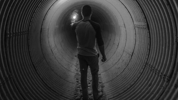 Man alone in a tunnel
