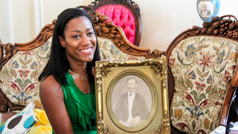 Alex's daughter Lexi Gee holds a photo of her great-great-great-great uncle, Robert Lafayette Gee. (Alex Gee)