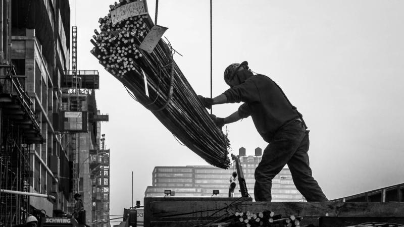 man moving steel