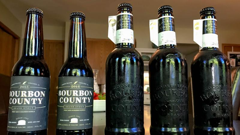 A five year vertical of Bourbon County Brand Stout. Older, pre-brewery sale style bottles are on the left, while the newer bottle design is on the right.