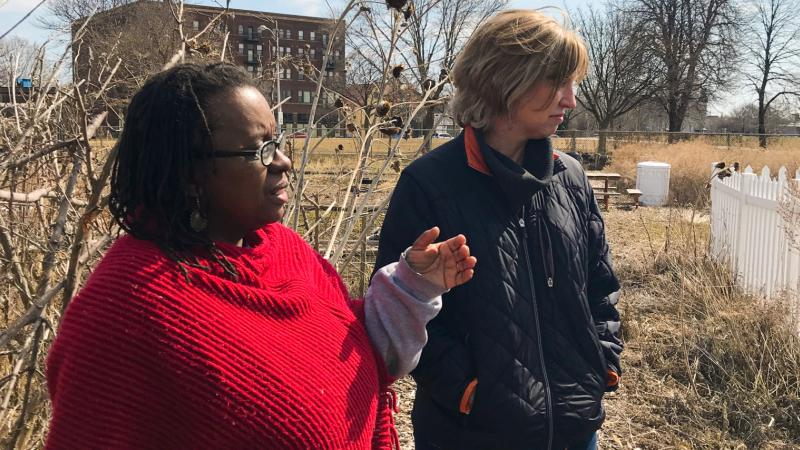 (Left to Right) Venice Williams, executive director of the Alice's Garden urban farming project, gives Anne a tour.