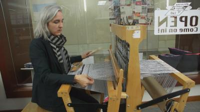 Fabric designer at loom