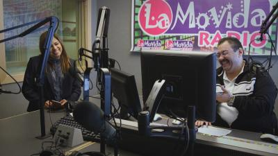 Luis and Lupita Montoto in audio booth at Spanish-language radio station