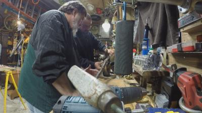 Son and father in workshop