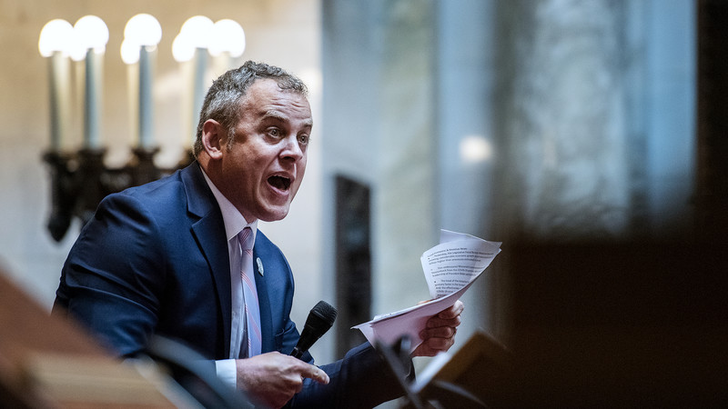 Assembly Minority Leader Gordon Hintz holds papers as he gives a speech.