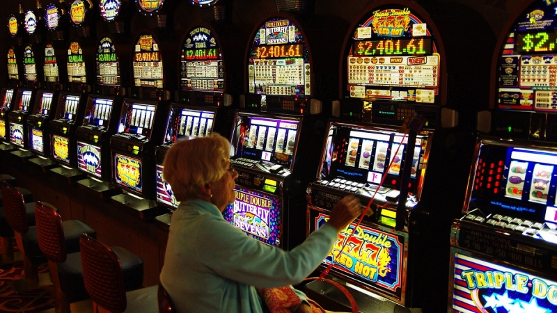 A lady playing the slots.