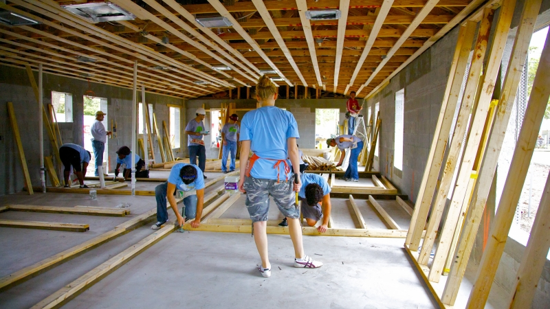 Workers inside a Habitat for Humanity Home.