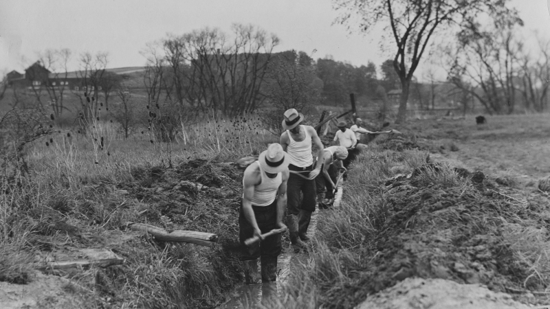 Civilian Conservation Corps workers digging a ditch