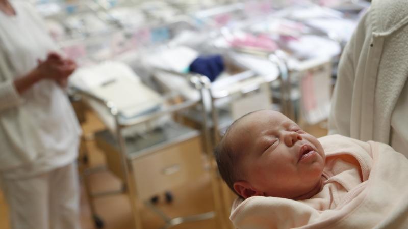newborn babies in a nursery