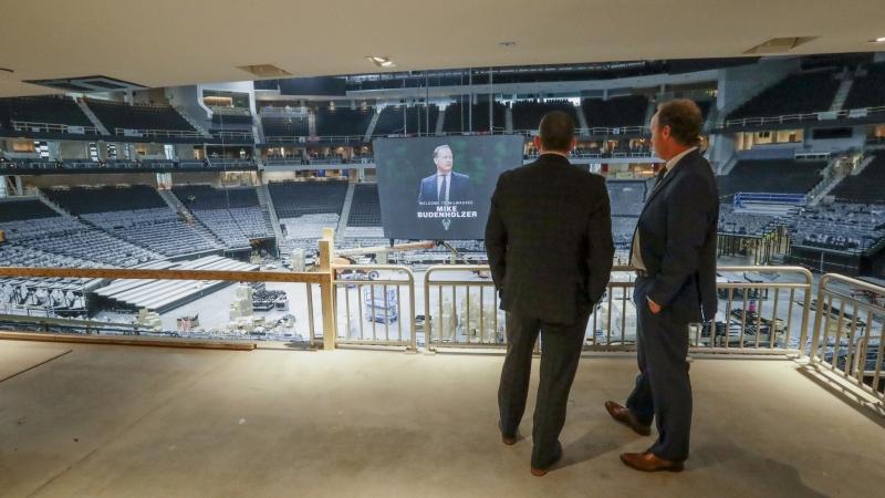 Milwaukee Bucks new head coach Mike Budenholzer talks to general manager Jon Horst