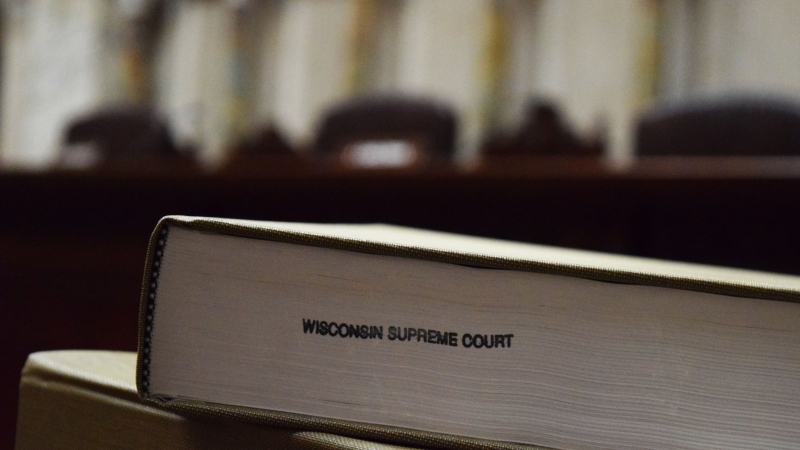 Law books in the Wisconsin Supreme Court courtroom