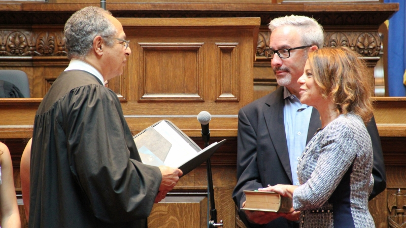 Former state Supreme Court Justice Louis Butler administers the oath of office to new Justice Rebecca Dallet