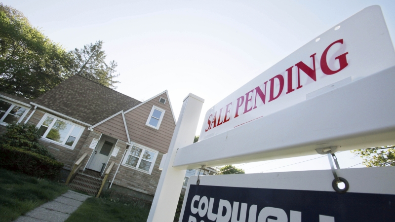 """""""Sale pending"""" sign for a house on the market"""