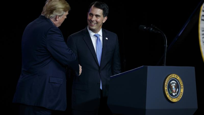 President Donald Trump shakes hands with Gov. Scott Walker