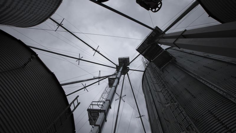 Farm silos overhead store corn on a rainy day